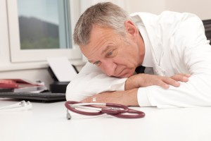 Overworked doctor having burn out