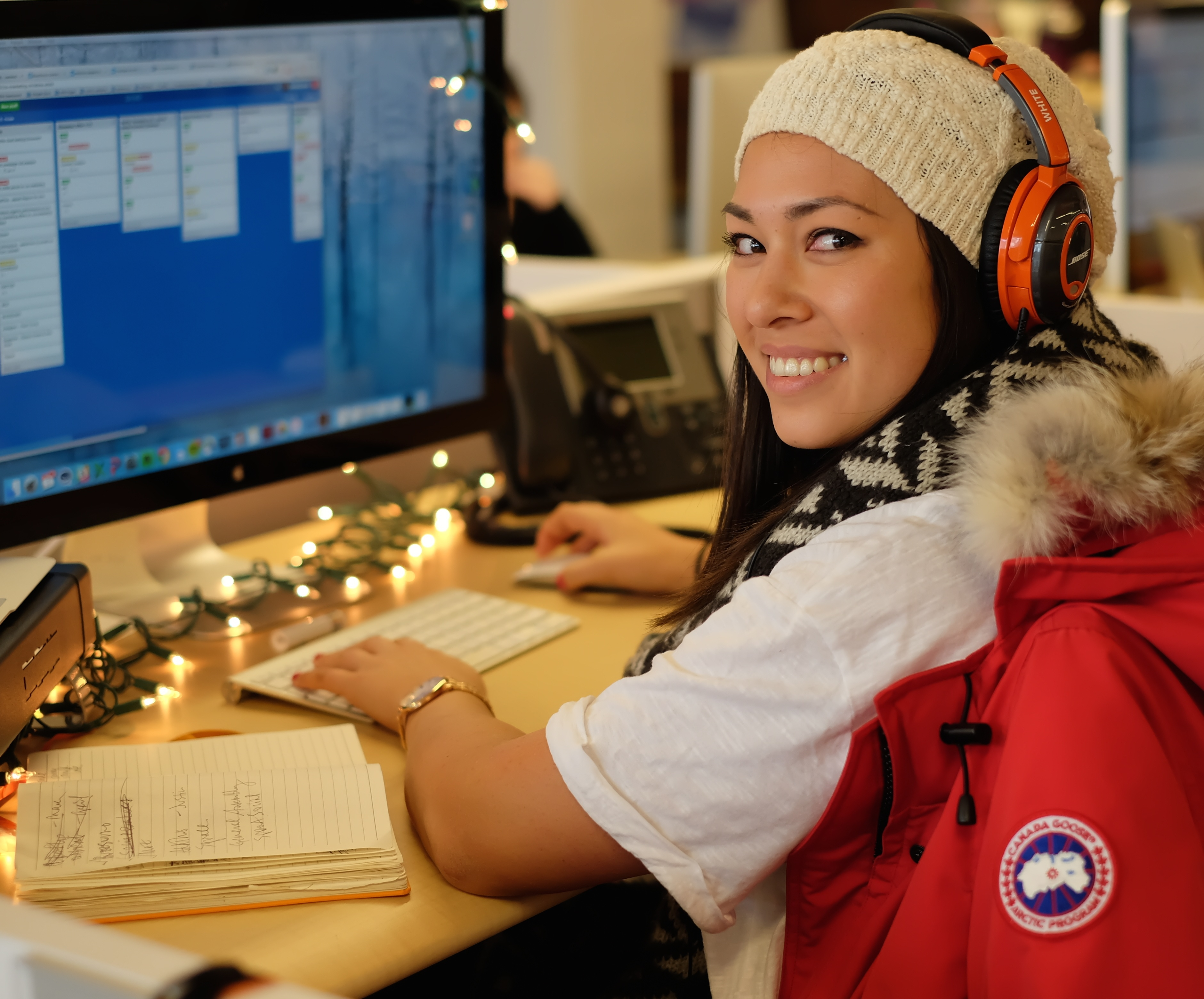 Edited_woman-smiling-at-desk-while-working.jpg